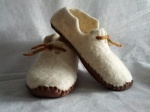 Natural light sheep wool, wet felted, leather soles
