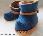Baby elves indigo booties with leather soles and ties