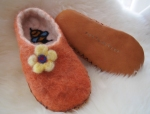 Girls Orange Slippers with a felted flower and leather soles